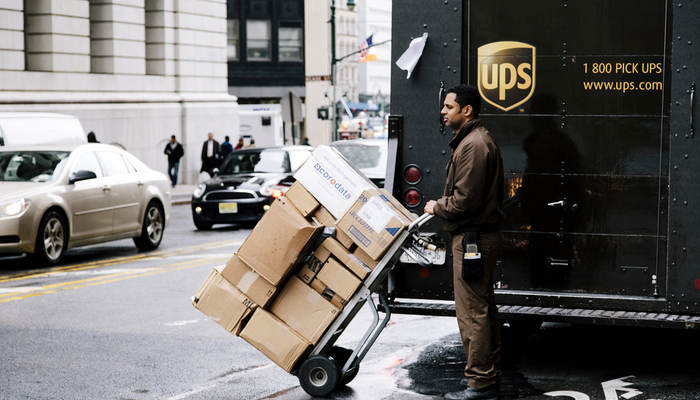 UPS to hire 100,000 people
